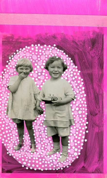 Vintage portrait of two baby girls holding theirs hands decorated with shocking pink colours.