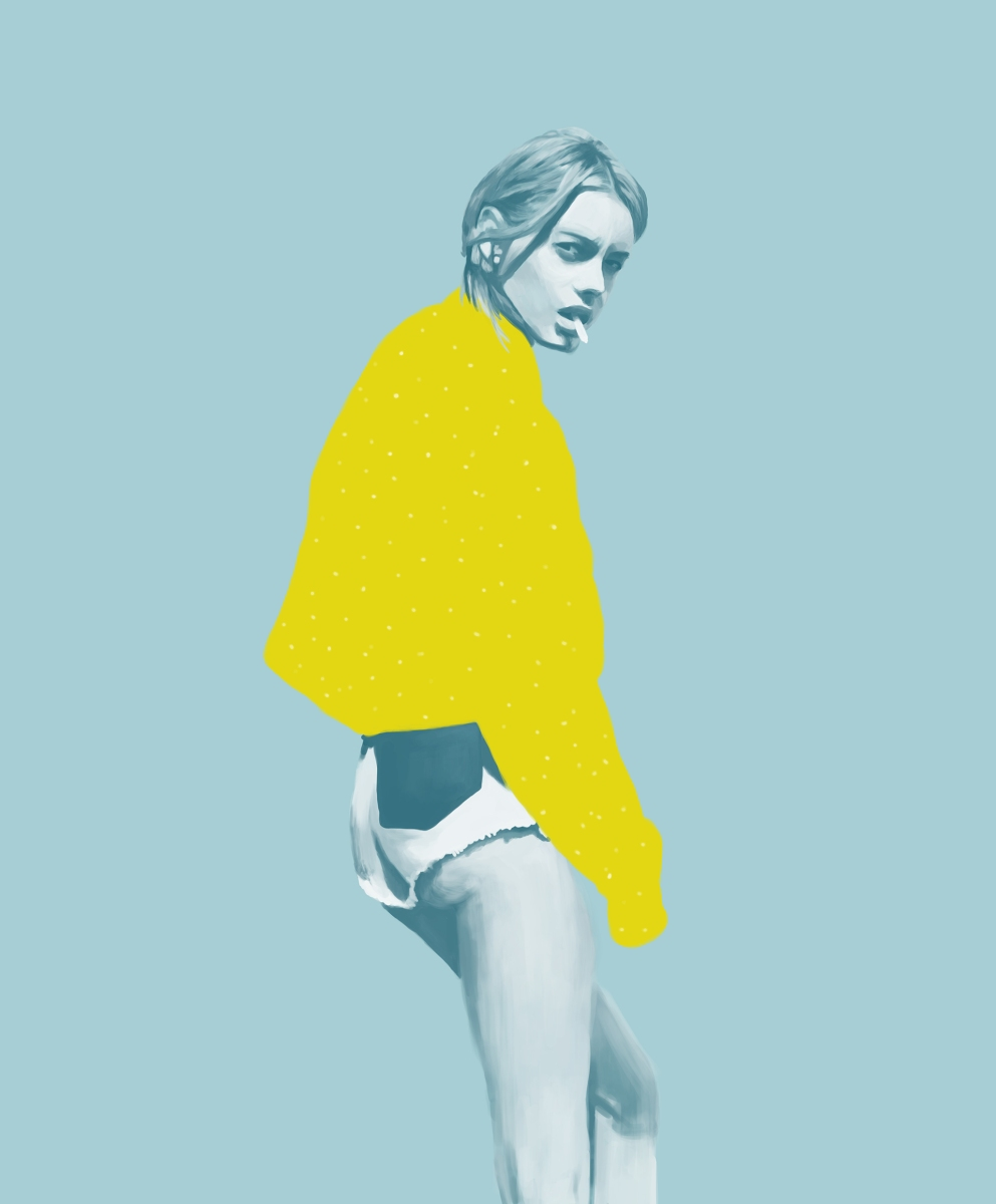 Woman portrait with a yellow jumper.