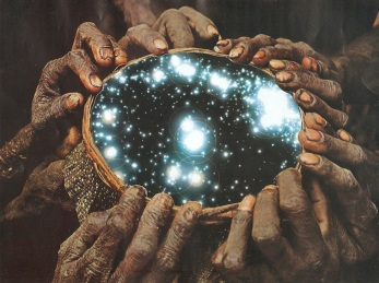 Hands holding a hole with the galaxy inside.