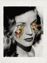 Woman portrait with flowers coming out from her eyes.