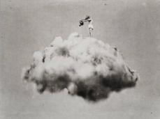 Boy watering a giant cloud.