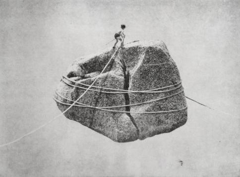 Boy hiking a giant floating rock.