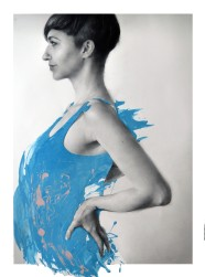 Profile portrait of a woman with short hair and the dress covered by a light blue paint.