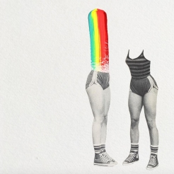 Two half bodies of women decorated with a rainbow paint.