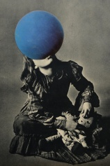 Woman portrait that is balancing a giant blue ball with her mouth.