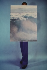 Paper cut of a sky over a woman full body photo.