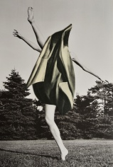 Paper cut over a full body woman outdoors.