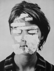 Woman portrait with the face covered by white paint.