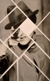 Fragmented photo of a man with a gun.