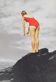 Woman in a red bath suit jumping from a rock in the sea.