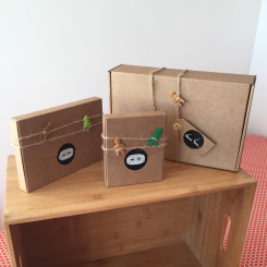 Still life photo of three kraft paper art gift boxes.