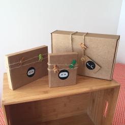 Still life photo of three kraft paper art gift boxes.
