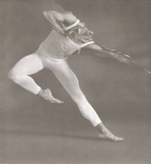 Black and white photo of a defaced male dancer.