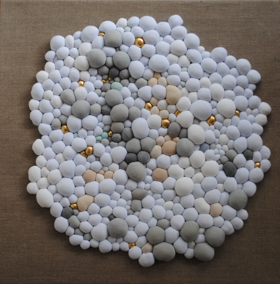 Frontal still life photo of a white-grey textile installation.