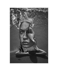 Partially defaced woman portrait collaged with other female body parts in an underwater environment.