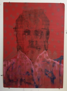 Red defaced portrait painting.