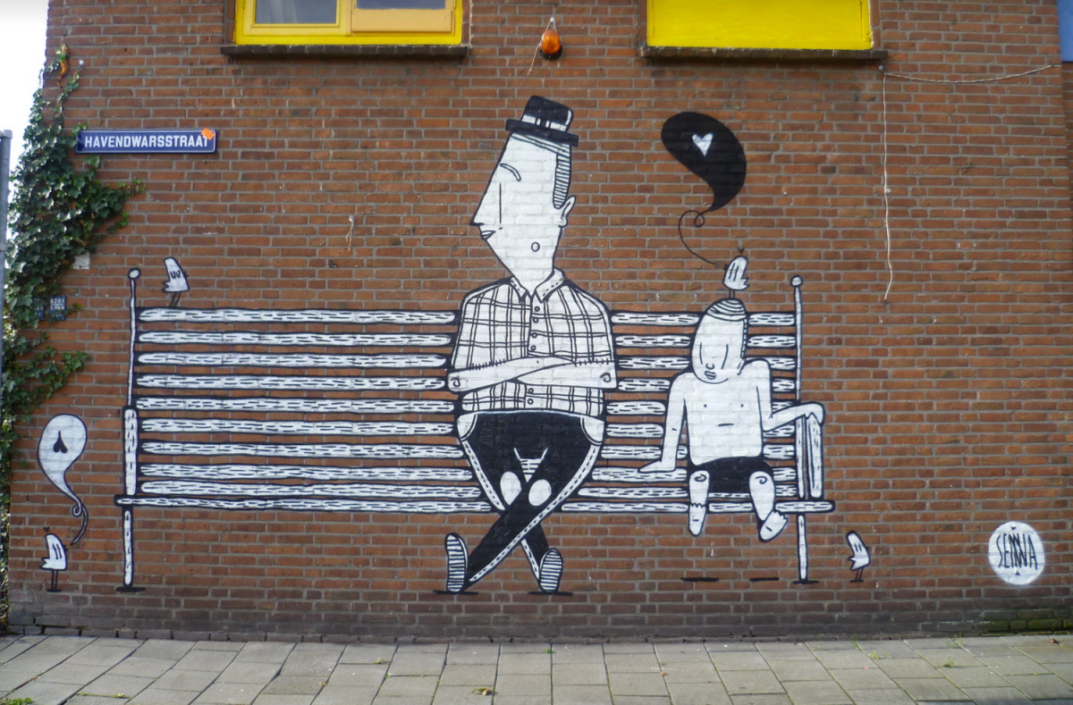 Photo of a brick wall decorated with an illustration of a man and a kid sit on a bench.