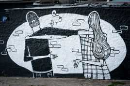 Photo of a wall decorated with an illustration of a couple embracing.
