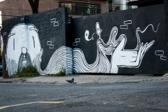 Photo of a wall decorated with an illustration of a man with a long beard.