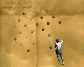Full body man seen from his back staring at an abstract dotty brown composition.