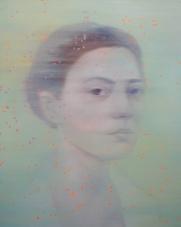 Woman portrait with dotty orange decorations.