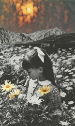 Little girl smelling flowers.