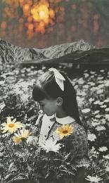 Little girl smelling flowers.