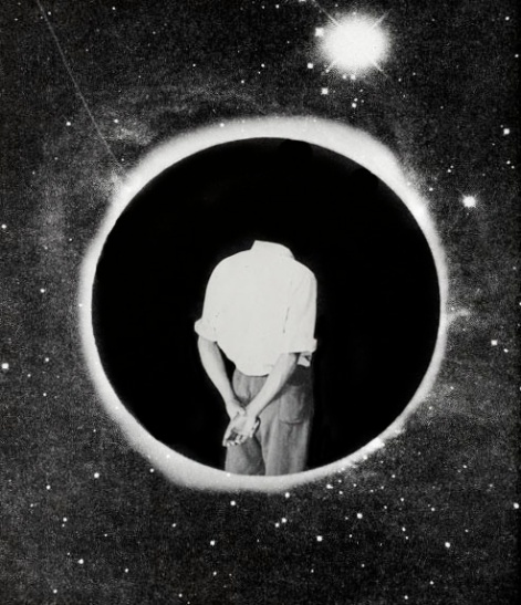 Man body seen from his back putted over an eclipse photo.