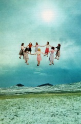 Group of baby girls holding hands and creating a circle, floating into the air.