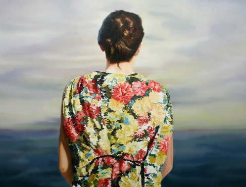 Woman with floral dress seen from the back.