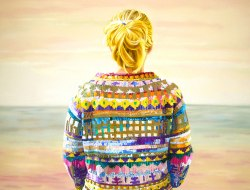 Blonde woman seen from the back.