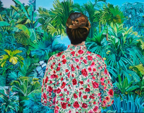 Woman with floral blouse seen from the back.