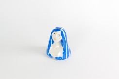 Still life photo of a ceramic of a woman with blue hair.