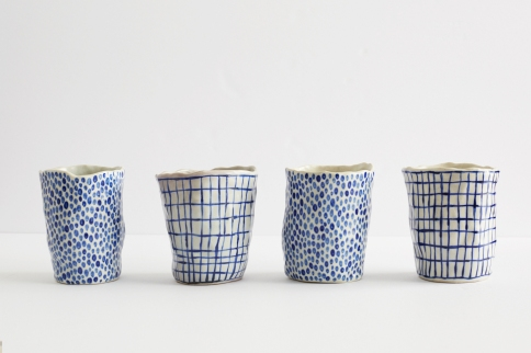 Still life photo of 4 cups.