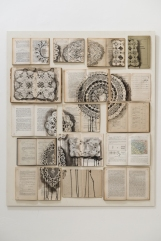 Vintage books installation with a doilies composition painted over.
