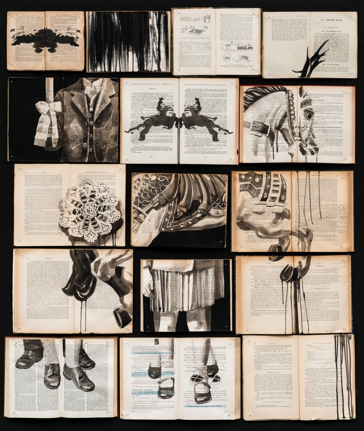 Vintage books installation with body portions and a horse toy painted over.