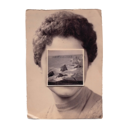 Vintage woman portrait with the face covered by a vintage seascape photo.