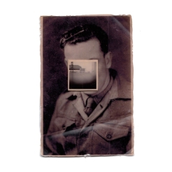 Vintage men portrait with the face covered by a vintage landscape photo.