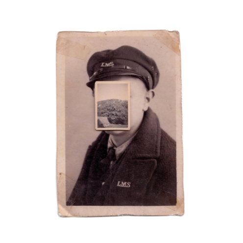 Vintage man portrait with the face covered by a vintage landscape photo.