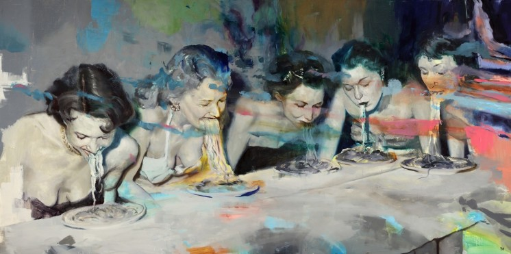 Group of women eating spaghetti around a table.
