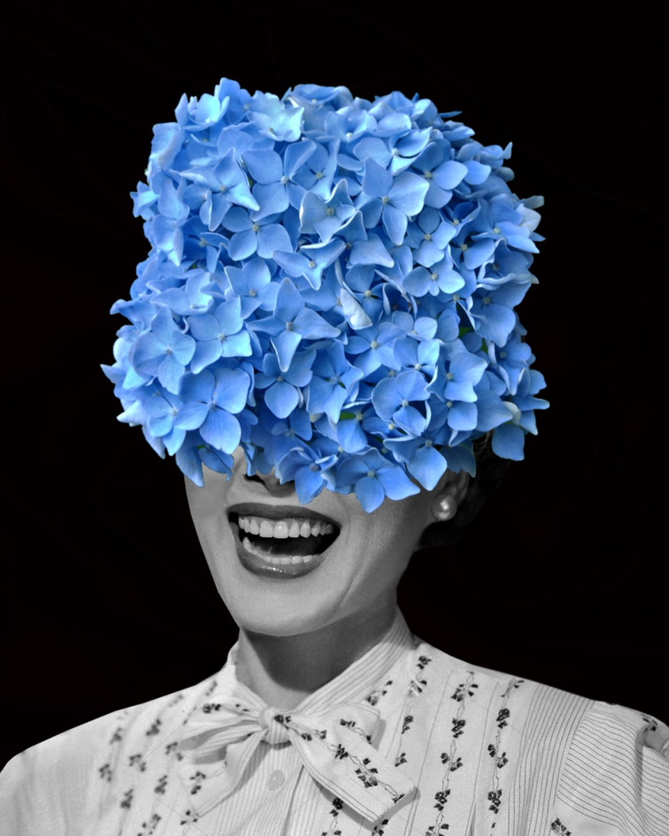 Vintage smiling woman portrait with the face covered with flowers.