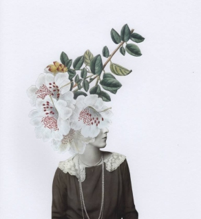 Female fashion portrait with the face covered by a giant flower.
