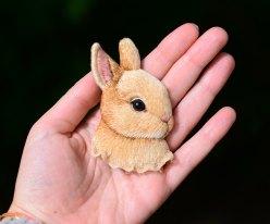 Still life of a rabbit brooch.