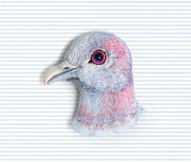 Still life of a bird brooch.