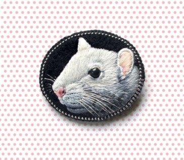 Still life of a mouse brooch.