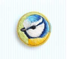 Still life of a bird brooch.