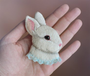 Still life of a rabbit brooch.