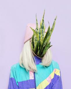 Faceless woman portrait with plants coming out from her face.