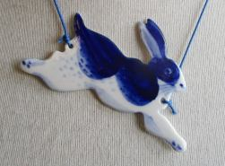 Still life of a porcelain rabbit shaped necklace.