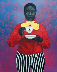 Portrait of a woman with a red shirt and black and white striped pants.